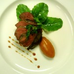 Pomegranate marinated pigeon breast on sweet potato hash with sorrel and quince aioli.