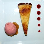 Italian lemon tart with strawberry gelato and raspberry coulis.