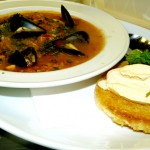 Bouillabaisse Provencal with rouille and a crouton.