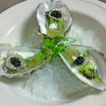 Rock oysters with sweet pickled cucumber, vodka creme fraiche, radish and caviar.