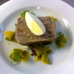 Old fashioned pork terrine with sweet piccalilli and a pickled egg.