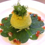 Twice baked goat's cheese souffle on wilted spinach with a roasted red pepper salsa and a pea shoot salad.
